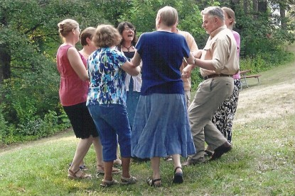 AFCI member Sophie is teaching us a traditional French dance during our annual Bastille Day picnic.
